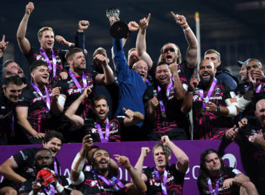 Bristol Bears chairman Chris Booy hoists the Challenge Cup trophy
